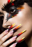 Beautiful girl in image of Phoenix bird with creative makeup and long nails. Manicure design. beauty face. Royalty Free Stock Photos