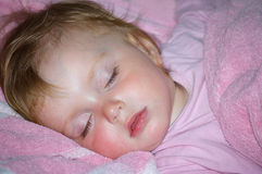 Beautiful Girl In A Pink T-short Sleeps Royalty Free Stock Photo