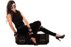 Beautiful Girl In Dark Leather Clothes Holding A Large Retro Radio Stock Image