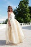 Beautiful Girl In Golden Gown Stock Photos