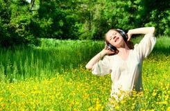 Beautiful Girl In Headphones Enjoying Music Royalty Free Stock Photos