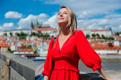 Free Beautiful Girl In Red Dress Travel In Prague Royalty Free Stock Photo - 124082585