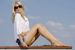 Beautiful Girl In Sunglasses On Blue Sky Stock Photo