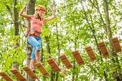 Free Beautiful Girl In The Park On The Ropes Achieve Outdoors Royalty Free Stock Photo - 143672365