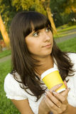 Beautiful Girl In The Park With Coffee Royalty Free Stock Photos