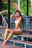 Beautiful Girl In White Bikini Posing In Bungalow Stock Photo