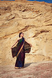 Beautiful girl with indian sari against sand background Royalty Free Stock Images