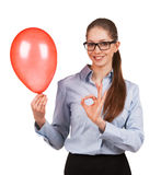 Girl with inflated balloon shows that all okay Royalty Free Stock Photo