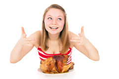 Beautiful girl  inhale the aroma of roasted chicken Stock Image