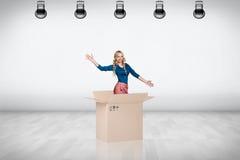 Beautiful girl inside a cardboard box Stock Image