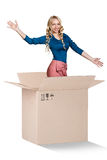 Beautiful girl inside a cardboard box Royalty Free Stock Images