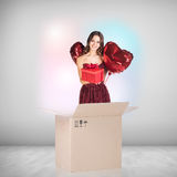 Beautiful girl inside a cardboard box with red ballooons Stock Photo