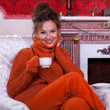 Beautiful girl inside a red vintage room with christmas decor Royalty Free Stock Photos