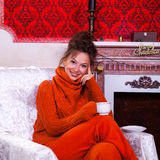 Beautiful girl inside a red vintage room with christmas decor Stock Photography