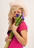 Beautiful girl with Irises Stock Images