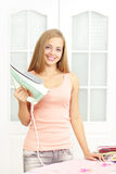Beautiful girl with an iron on Royalty Free Stock Photo