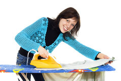 Beautiful girl ironing clothes Stock Image