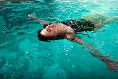 Beautiful Girl Is Relaxing In The Spa Pool,swim And Relax. Young Woman Floating Royalty Free Stock Photo