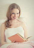 Beautiful Girl Is Resting In Bed, Reading Book Stock Images