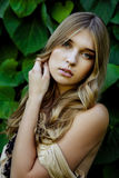 Beautiful girl by ivy wall Royalty Free Stock Photography