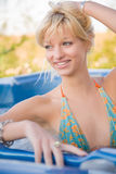 Beautiful girl in Jacuzzi Stock Images