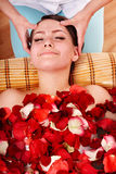 Beautiful girl in jacuzzi with rose petal. Stock Photos