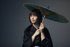 Beautiful girl with japan umbrella Royalty Free Stock Images