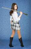 Beautiful girl with japanese sword on a shoulder. Beautiful girl on blue background with  sword on a shoulder Stock Photo