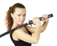 Beautiful girl with japanese weapon Royalty Free Stock Photos