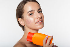 Beautiful girl with jar of sunscreen lotion Stock Images