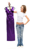The beautiful girl in jeans. Chooses a lila dress Royalty Free Stock Images