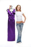 The beautiful girl in jeans. Holds a lila dress Stock Photography