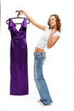 The beautiful girl in jeans. Holds a lila dress Stock Images