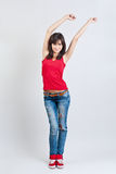 Beautiful girl in jeans dancing Royalty Free Stock Photo