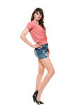 Beautiful girl in jeans mini skirt. Isolated Stock Images