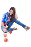 Beautiful girl in jeans with red apples Royalty Free Stock Photo