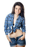 The beautiful girl in jeans shorts Royalty Free Stock Image