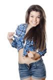 The beautiful girl in jeans shorts Stock Photography