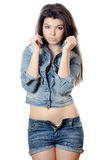 The beautiful girl in jeans shorts Stock Image