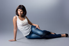 Beautiful girl. In jeans and a white blouse Royalty Free Stock Images
