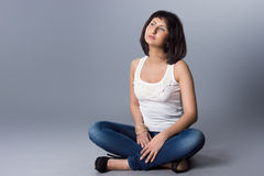 Beautiful girl. In jeans and a white blouse Royalty Free Stock Photography