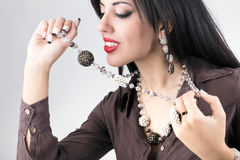 Beautiful girl with jewelry. beauty young woman make-up Royalty Free Stock Images
