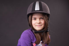 Beautiful girl in jockey cap Stock Images