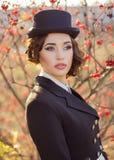 Beautiful girl jockey posing Stock Photography