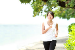Beautiful girl jogging on the beach Stock Image
