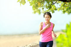 Beautiful girl jogging on the beach Royalty Free Stock Image