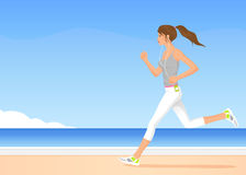 Beautiful girl jogging by the sea Royalty Free Stock Photography