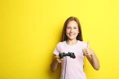 Beautiful girl with joystick Stock Images