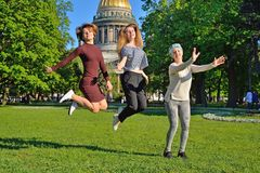 Beautiful girl jumping on the background of St. Isaac`s Cathedra stock images