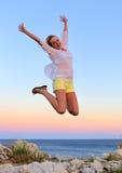 Beautiful Girl Jumping Stock Images